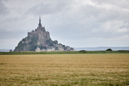 Mont Saint-Michel on sunny day with clouds