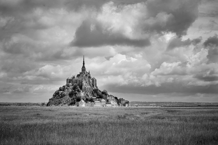 Mont Saint-Michel on sunny day with clouds in b  w Stock Photo
