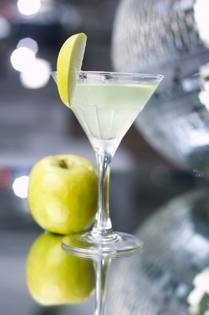 alcoholic cocktail with apple on a glass table