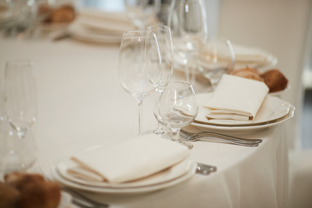 table setting in beige shades in a restaurant