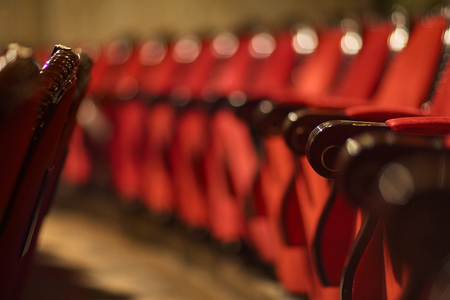 rows of red chairs in the theater