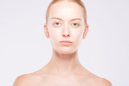 beautiful blonde without makeup on white background Stock Photo