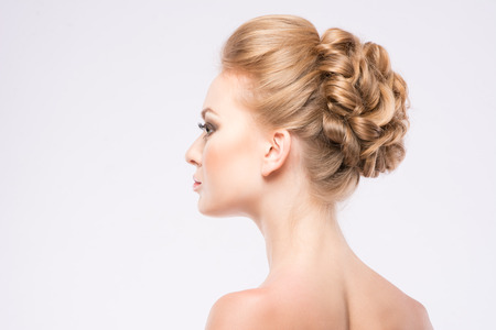 girl with a beautiful hairdress on white background Stock Photo