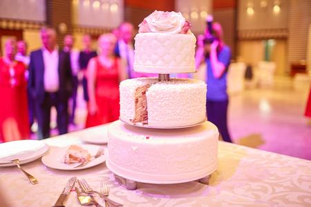 beautiful white wedding cake on the table