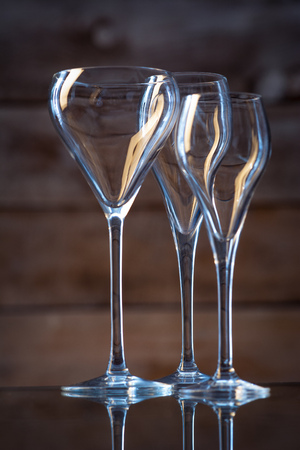 glasses of different shapes on a wooden background 版權商用圖片