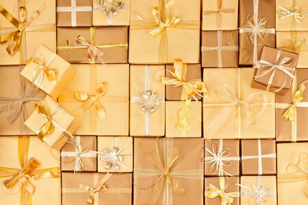 many golden gift boxes with ribbons Standard-Bild - 131965415