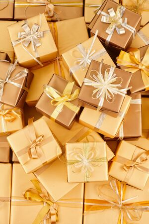 many golden gift boxes with ribbons Standard-Bild - 131965496