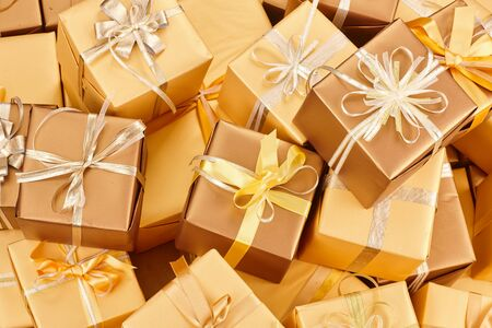 many golden gift boxes with ribbons Standard-Bild - 131966049