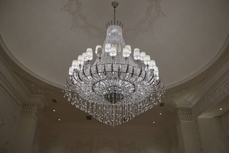 Crystal chandelier in the wedding hall Stock Photo