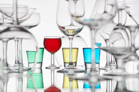 glasses with colorful drinks on a white background
