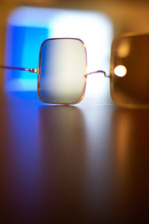 glasses for vision on a table on a colorful background