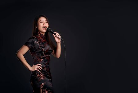 Korean girl with a microphone in hand sings