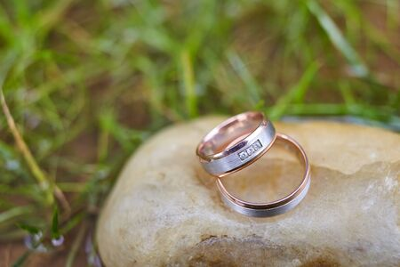wedding gold rings for newlyweds on a stone, rings for a wedding