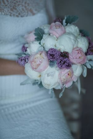 bride in a wedding dress holding a bouquet