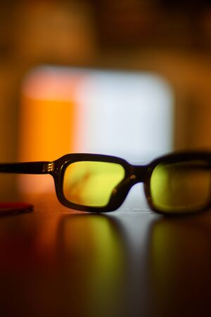 glasses for vision are on the table