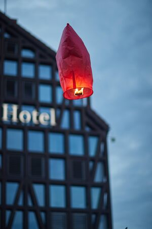 fiery balloon launched into the sky above the city Reklamní fotografie