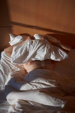 a man lies on a bed at sunrise Reklamní fotografie