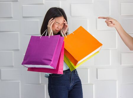 Sad woman crying scolded by husband because she spend a lot of money for shopping