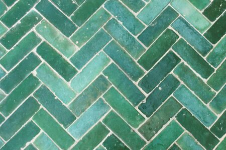 Green tile floor decorated outdoors.