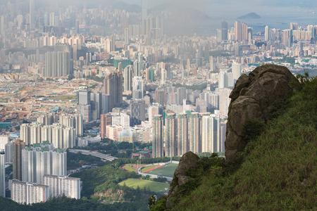 hazy: Hazy Hong Kong city skyline,an aerial view from Kowloon peak