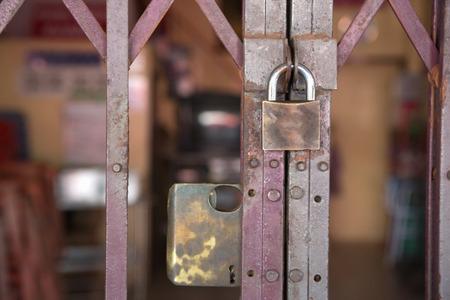 keep gate closed: steel lock on a door