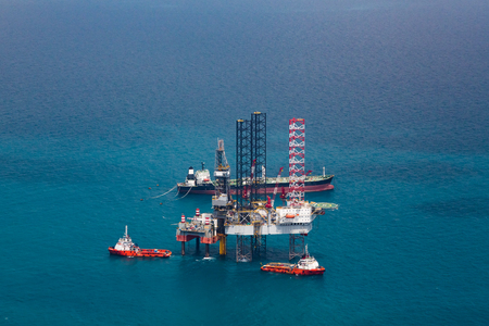 power boat: Offshore oil rig drilling gas platform