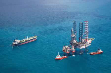 energy channels: Offshore oil rig drilling platform Stock Photo