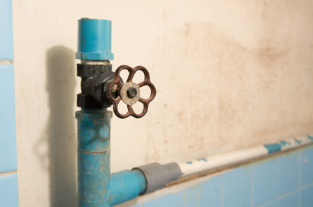 stop gate valve: Old pipelines with rusty valve, plumbing in the 80s