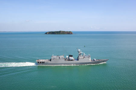 warship: Grey modern warship sailing in still water