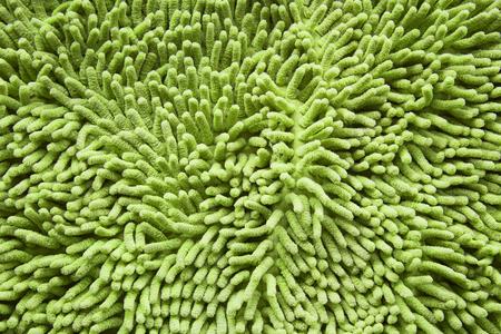 doormat: green cleaning doormat or carpet texture
