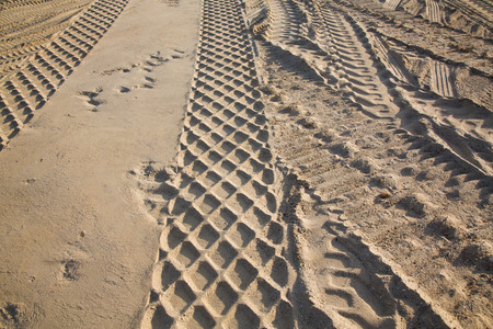 gravel pit: wheel track in the sand