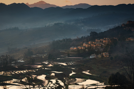 terracing: Beautiful morning sunrise with rice terrace and village on hill,Yunnan,China