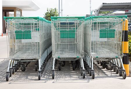 grocery store series: Row of shopping carts on a parking lot