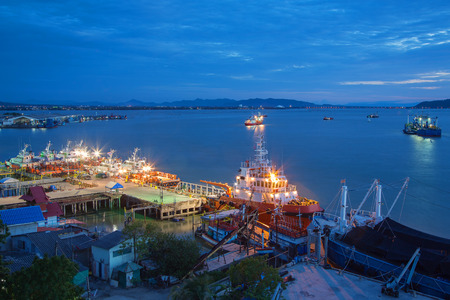 Sea port in Thailand with blue hour,twilight time Stock Photo