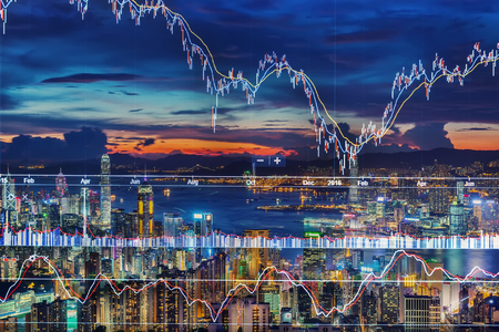 Double exposure of stocks market chart and Hong Kong city of business,concept