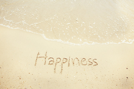 Handwritten Word Happiness On Sand Of Beach with vintage style,background and texture 版權商用圖片