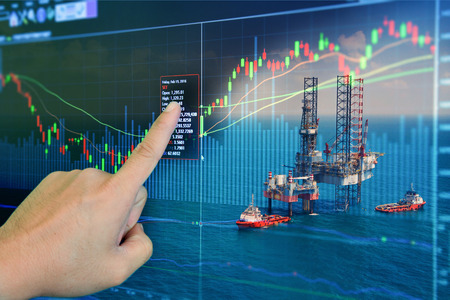 Stock market concept with oil rig in the gulf background,Double exposure