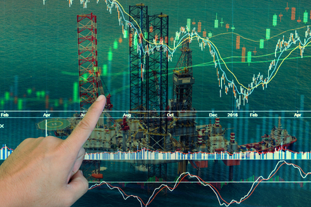 industry background: Stock market concept with oil rig in the gulf and oil refinery industry background,Double exposure
