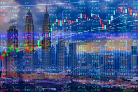 Stock market concept with cityscape background Foto de archivo