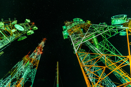 Telecommunication towers for mobile communications and TV antennas in the starry night