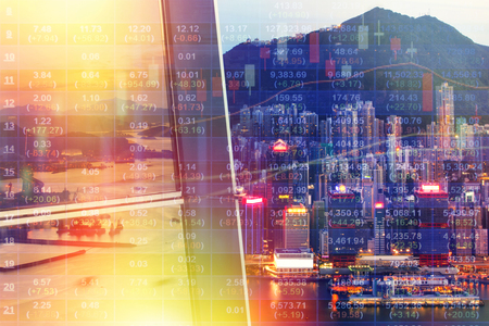 Double exposure of stocks market chart on LED display concept with city scape hong kong background Stock Photo