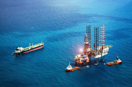 Offshore oil rig platform in the gulf from aerial view Editorial
