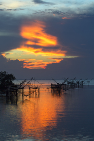 Sunrise with fishing net on the lake