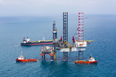 Offshore oil rig platform in the gulf from aerial view Stock Photo