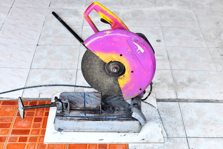 circular saw on floor tiles