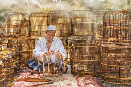 Old man making cage of bird in South of Thailand,Handmade