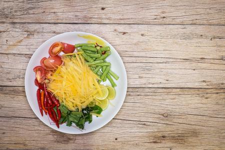Prepare papaya salad ingredients for Thai food. With spicy taste