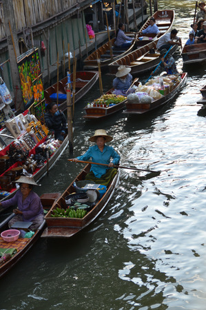 tourist attraction: Damnoen Saduak, Thailand - December 31 : Unidentified vendor paddle for sell goods on December 31, 2015 in Damnoen Saduak Floating Market, Ratchaburi, Thailand. Damnoen Saduak Floating Market is tourist attraction for boat tour such as purchase or shoppin Editorial