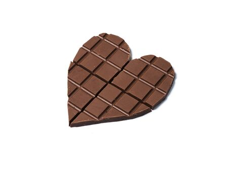 heart shape Black Chocolates bars on white isolated background.