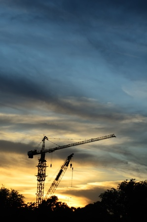 contruction: Silhouette of contruction crane at sunset Stock Photo